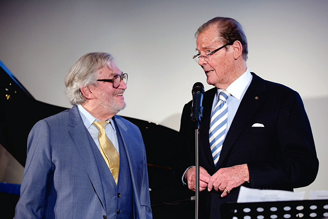 Monty with Sir Roger Moore at BAFTA April 2016